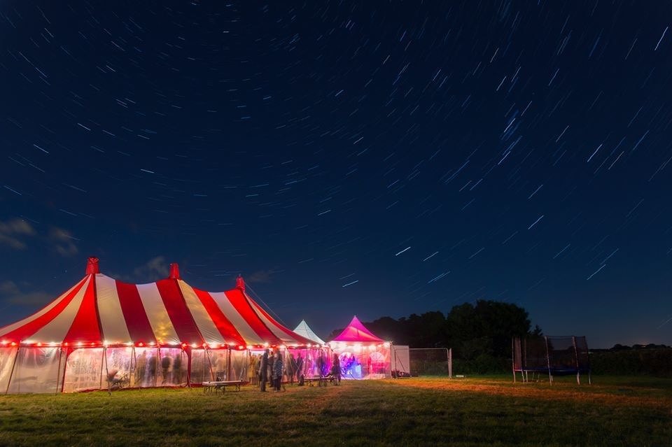 Colourful marquee under night sky