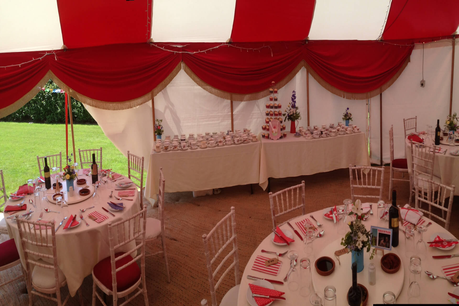 Colourful red & white wedding reception marquees