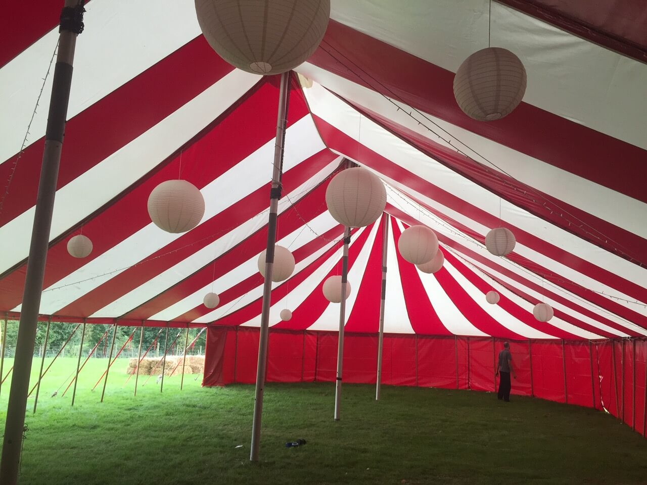 Large round paper lanterns hung in colourful marquee