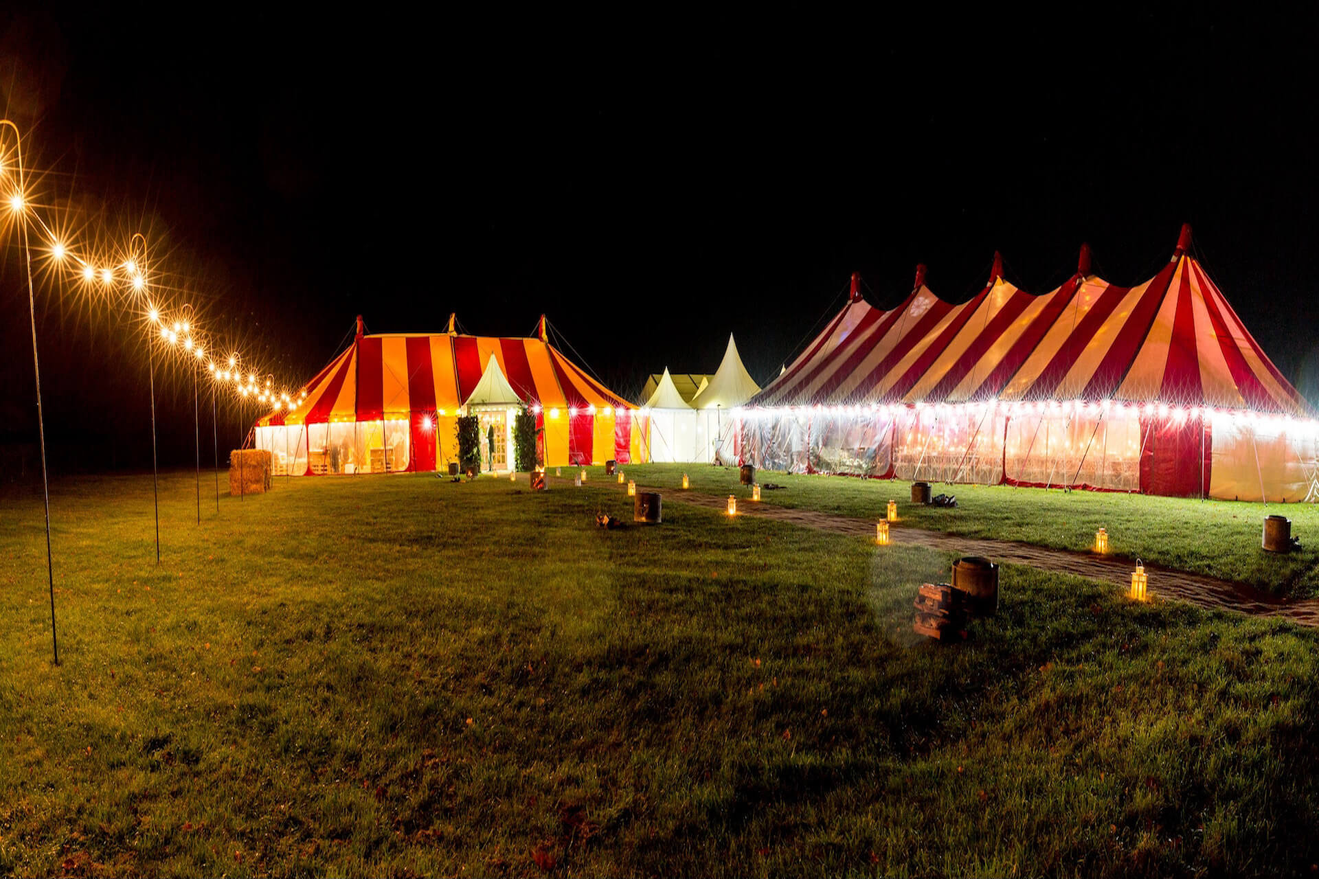 Colourful wedding tents at night