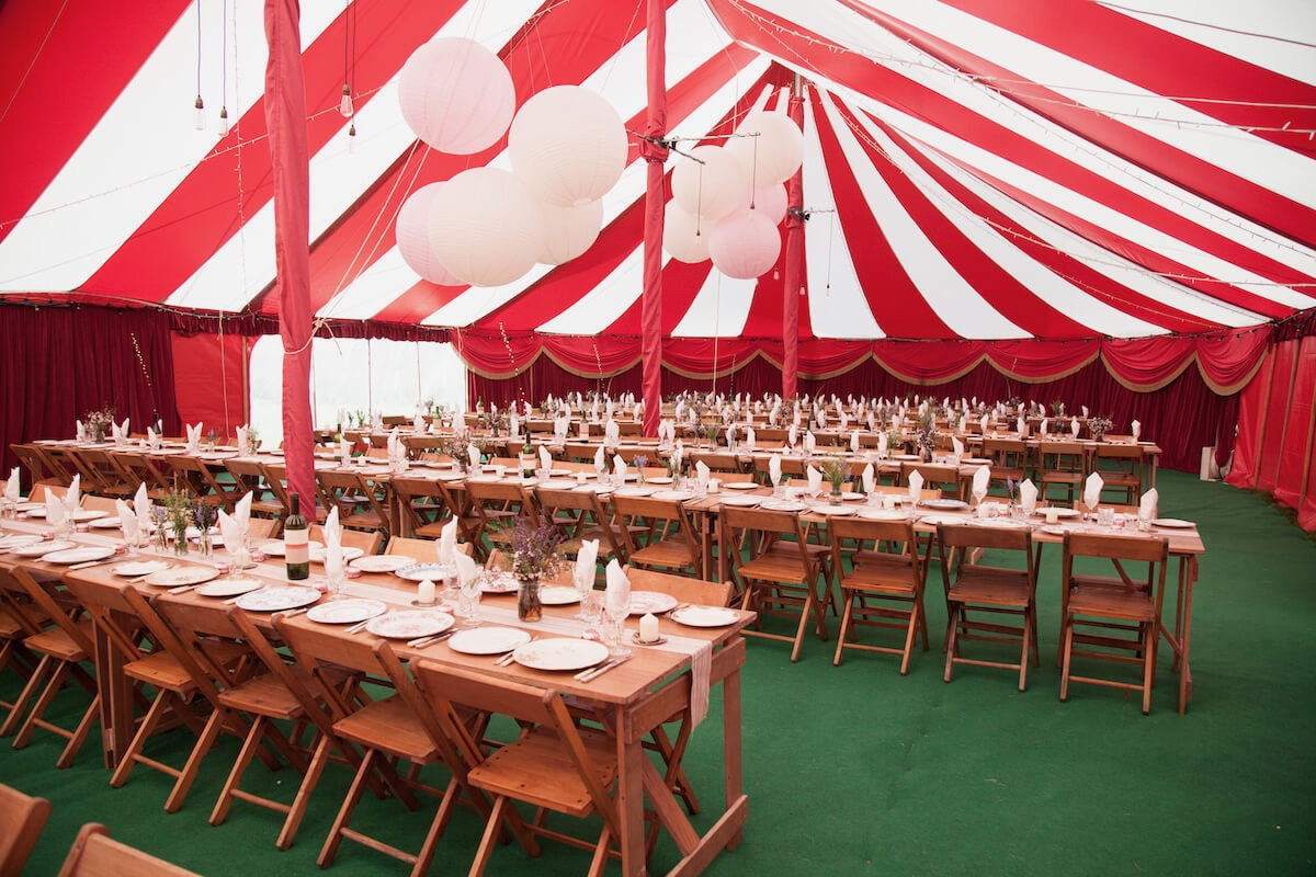 Giant Paper lanterns in striped circus theme wedding marquee