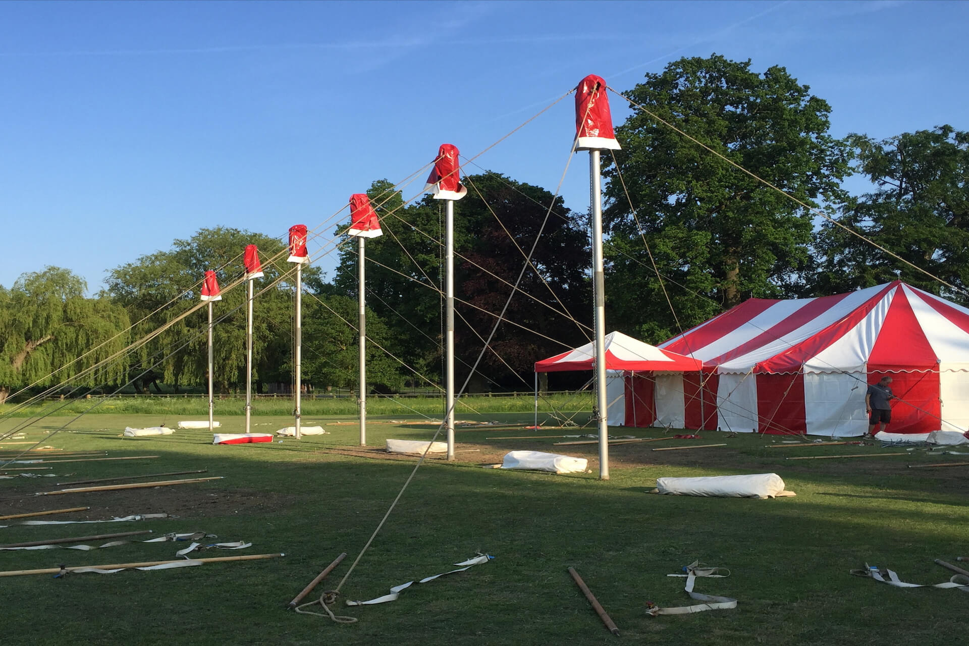Red & white marquees being installed