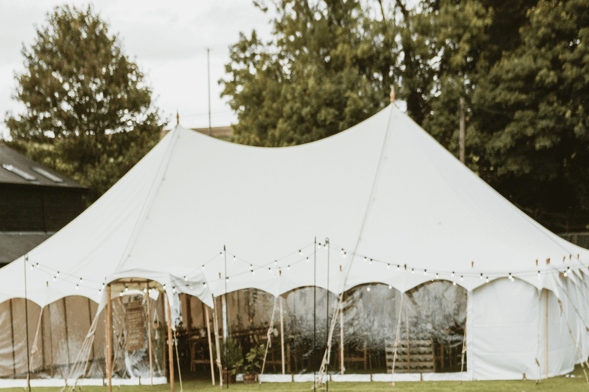 White canvas petal pole marquee wedding tent