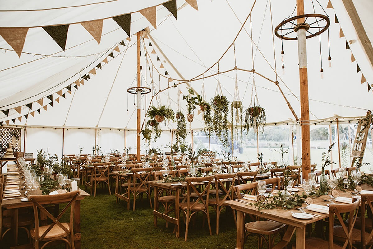 Boho chic styled wedding marquee interior using natural materials as decorations
