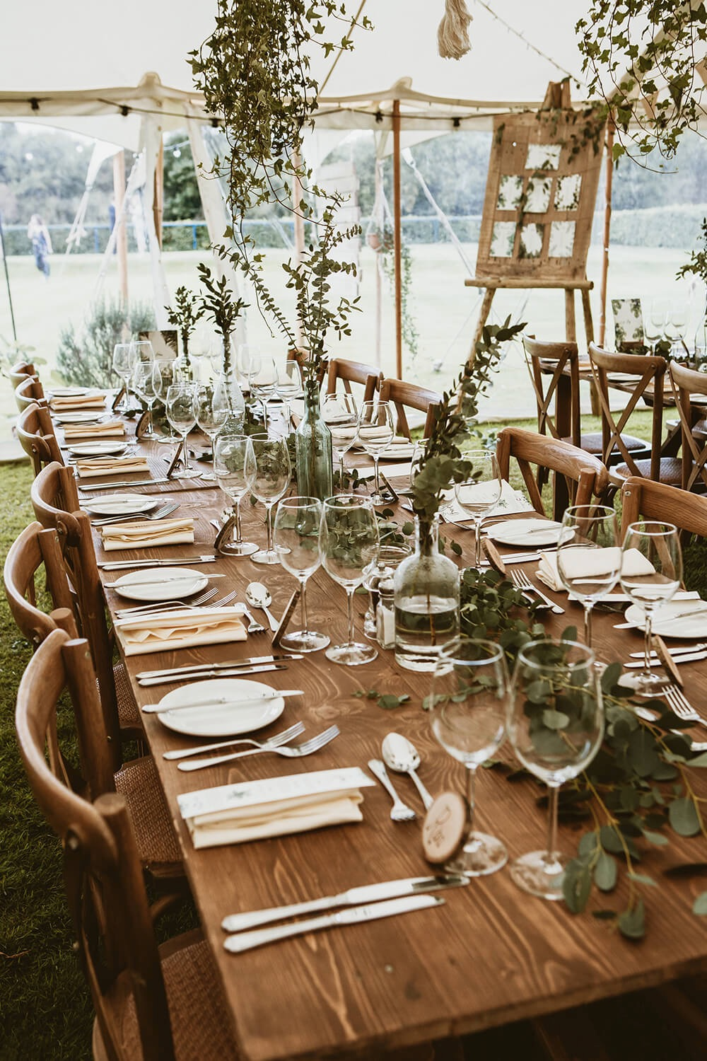 Tablescape with natural table decorations using flowers in wedding marquee