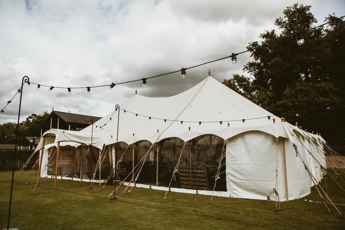Traditional white petal pole wedding marquee on hire from Bigtopmania