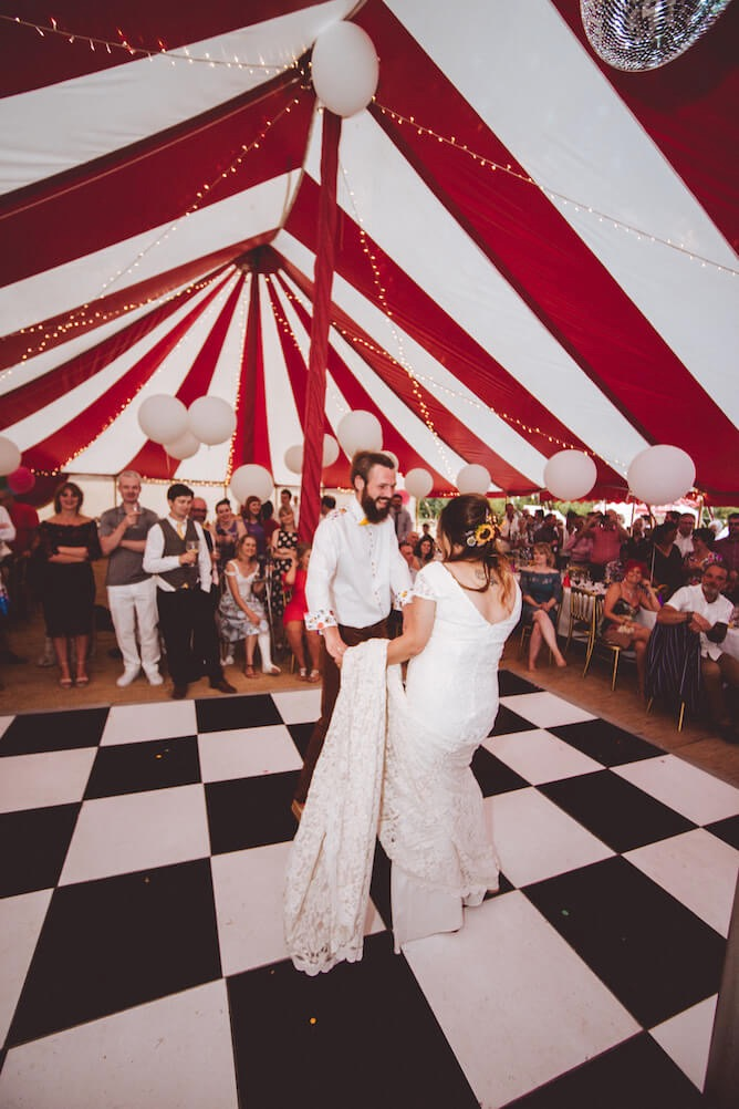 Festival wedding couples first dance at big-top wedding