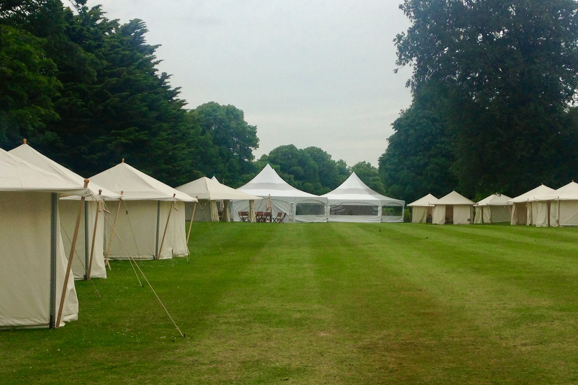 Social distance bubbles, canvas tents at a garden party