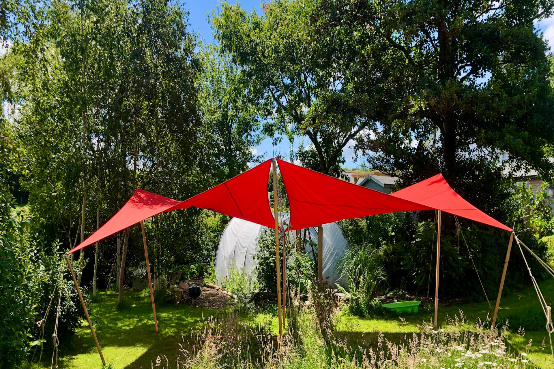 Two red 4m x 4m shade sails 9ft poles