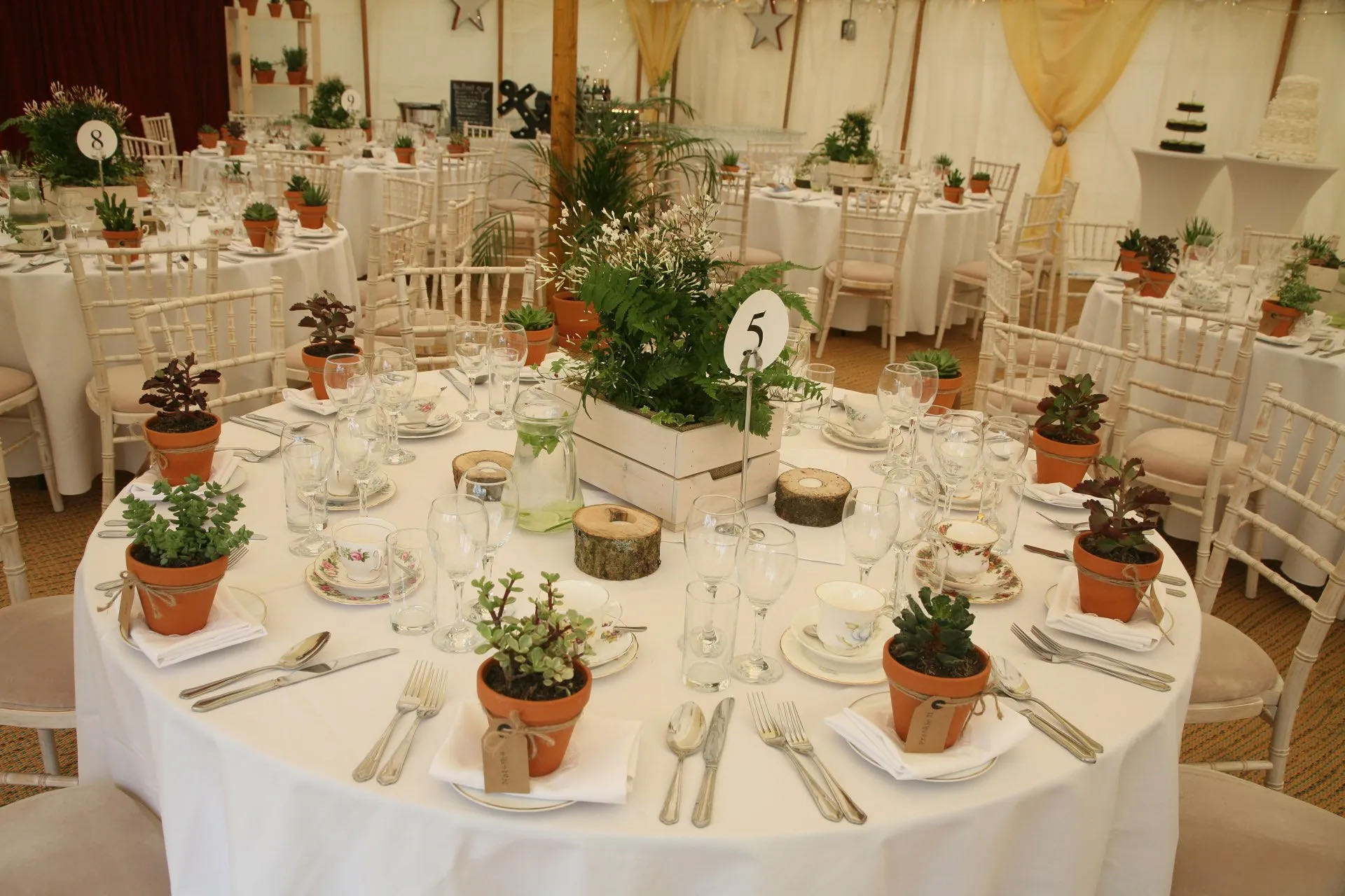 Beautiful round wedding tables in marquee