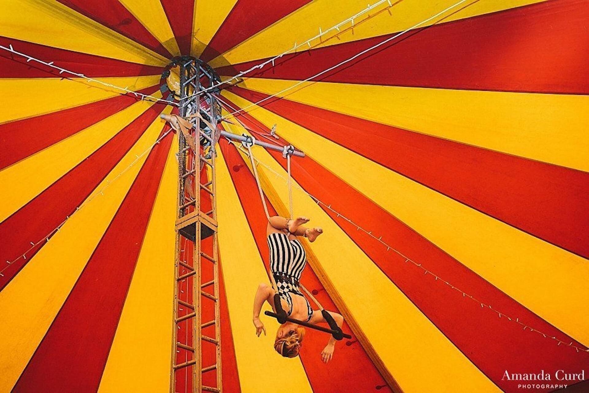 Trapeze artsist in small bigtop