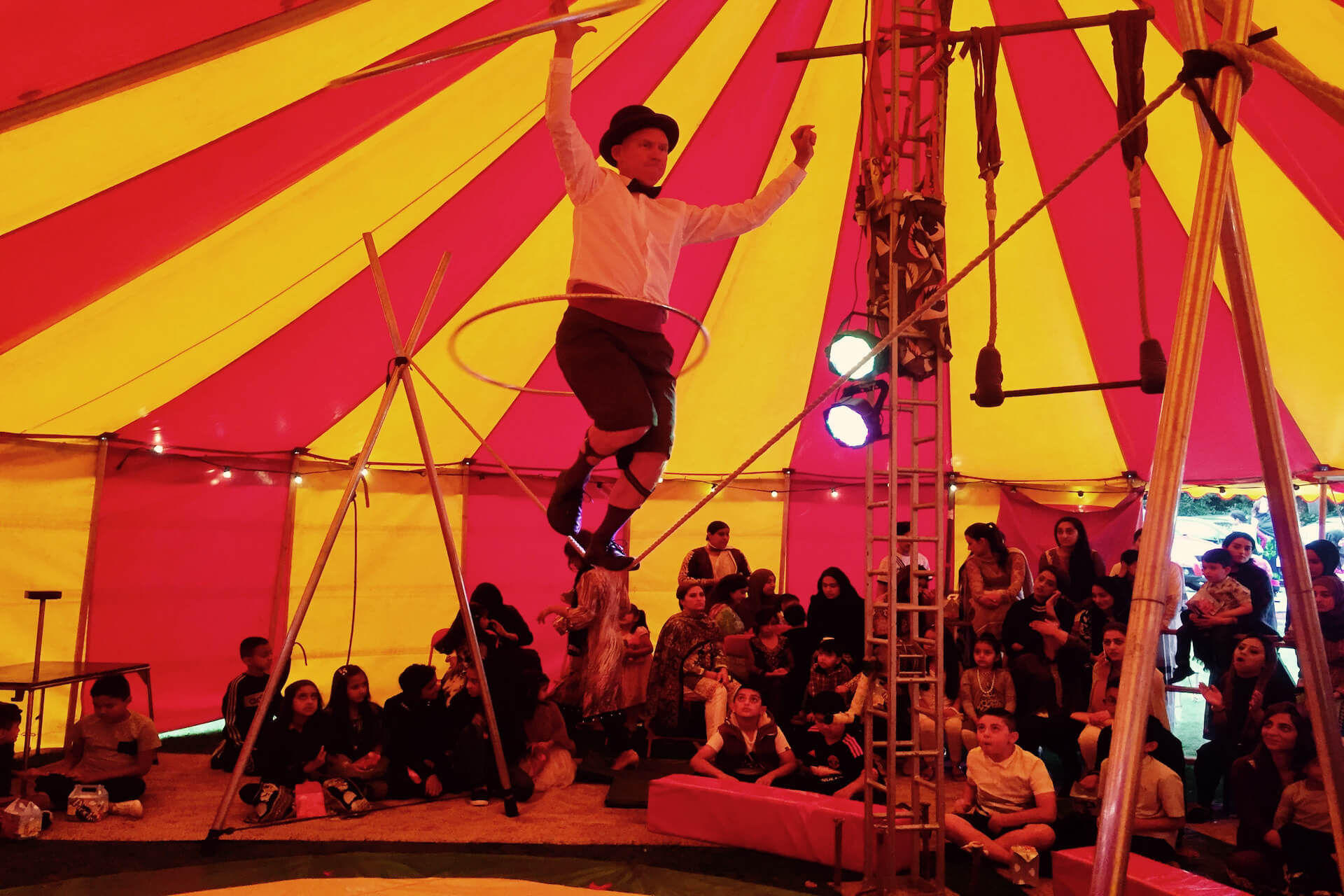 Tight rope walker in party tent