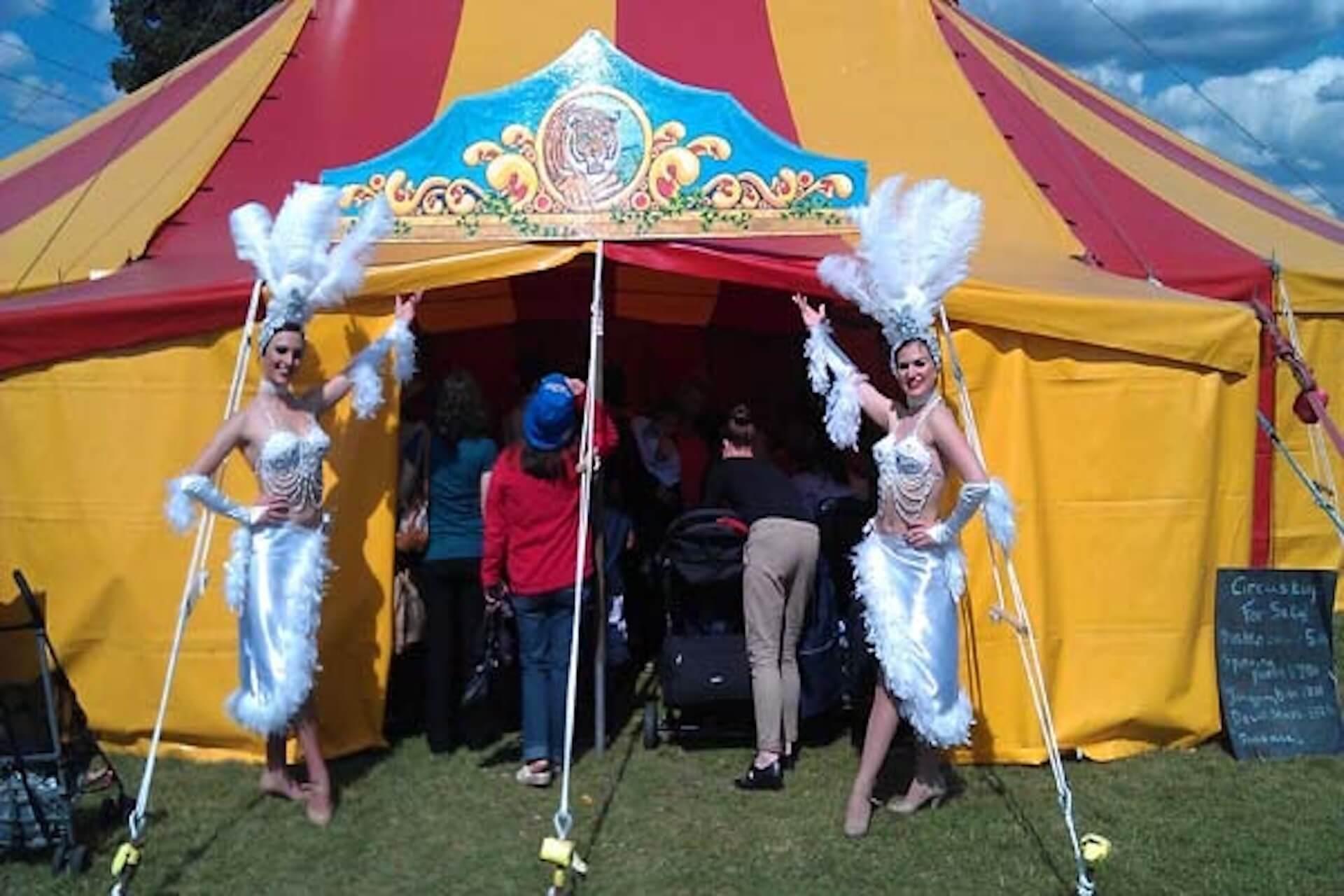 Vegas dancers in front of circus tent London