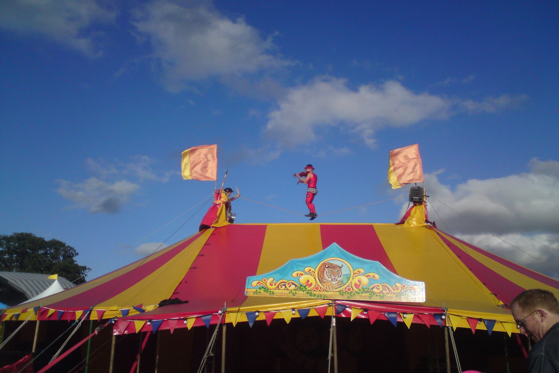 Kwabana Lindsay on the top of circus tent at Guilfest