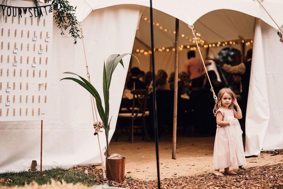 Bigtopmania  wedding marquee with bridesmaid in front