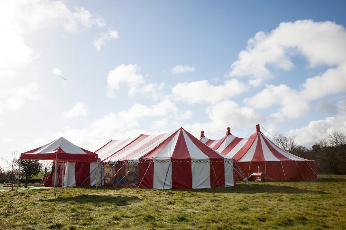 A group of red and white circus style marquees for rent and hire