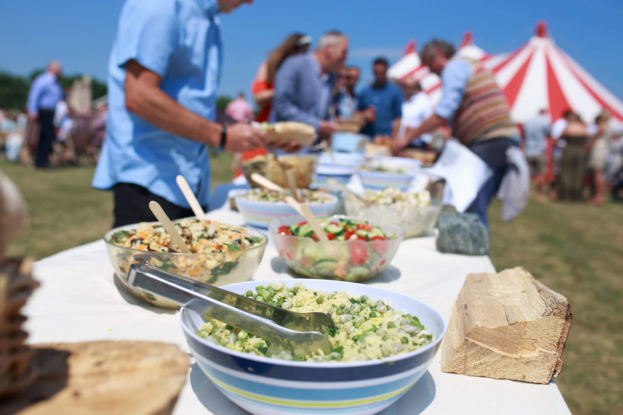 Outdoor buffet at a sunny wedding
