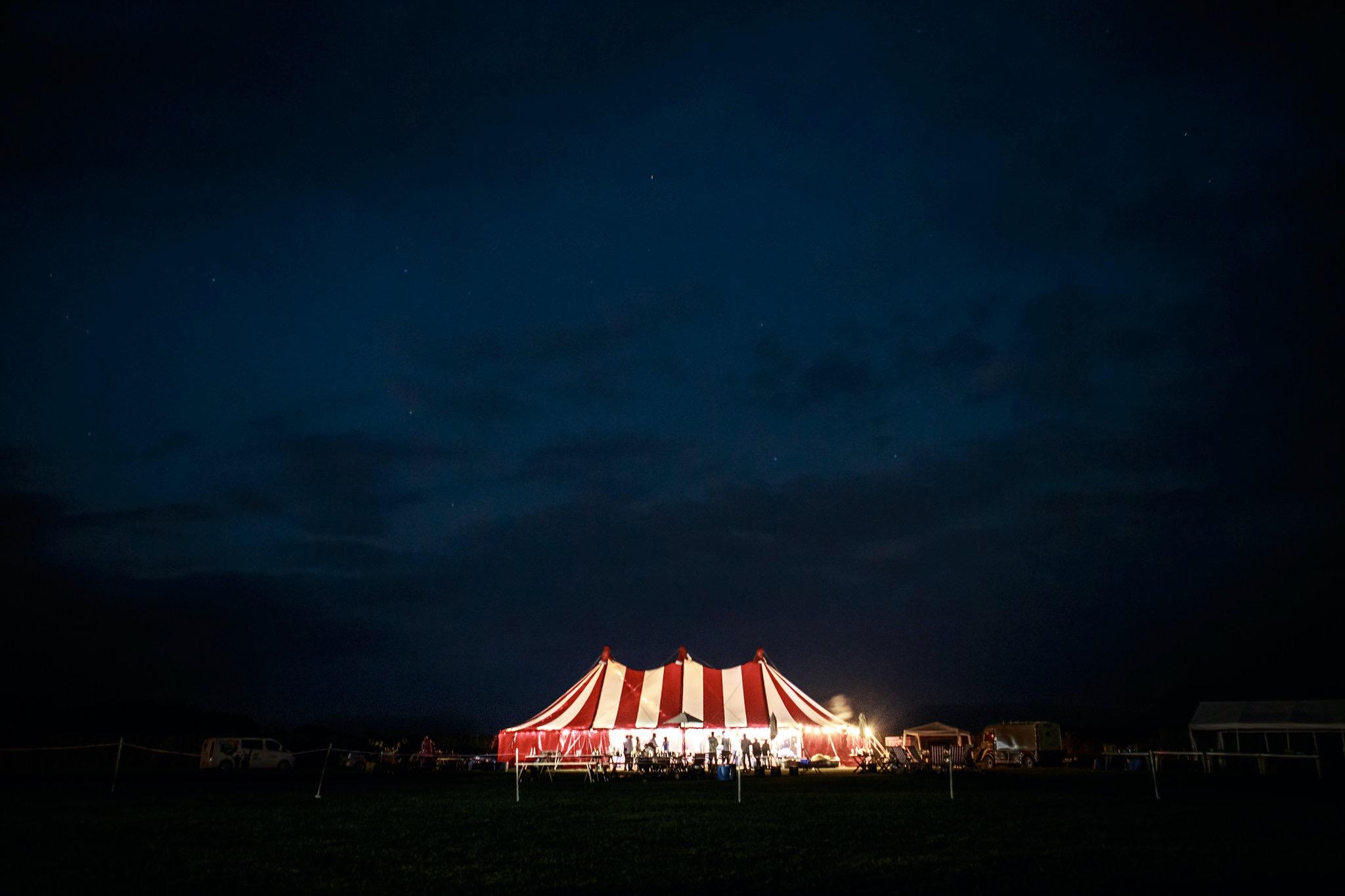 Circus tent wedding at night
