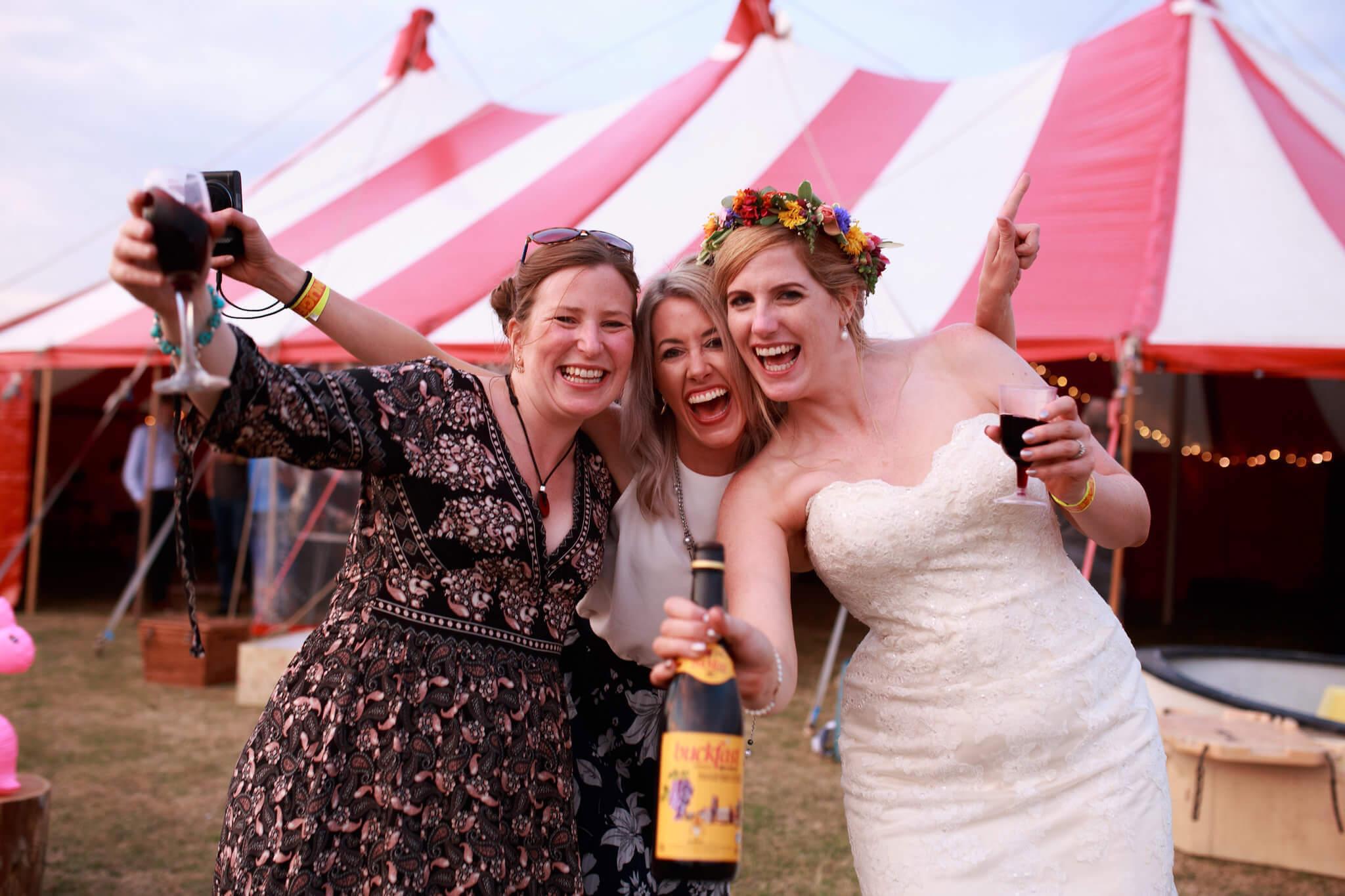 Guests posing at fun outdoor wedding
