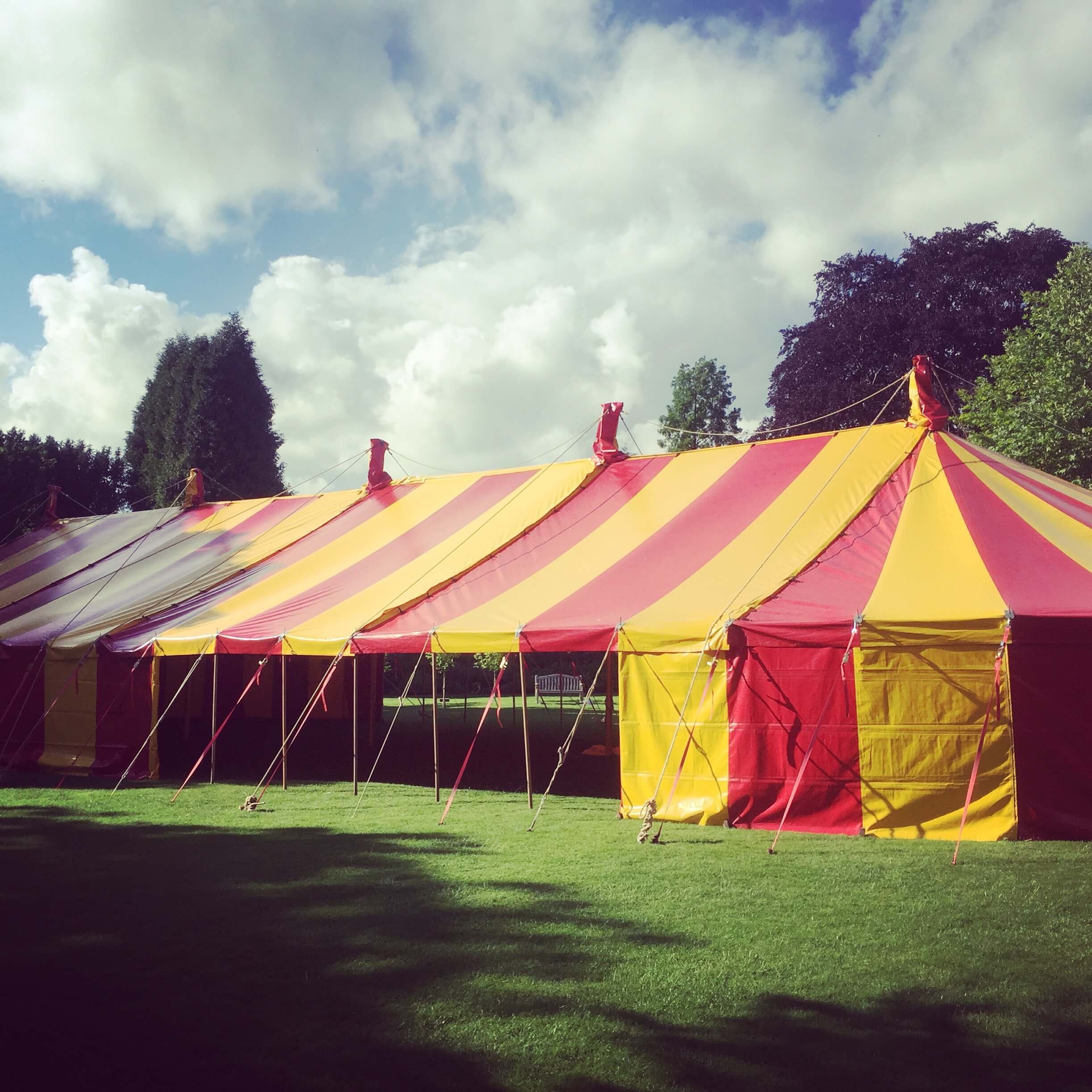 Queen, a 12m x 40m striped red & yellow marquee