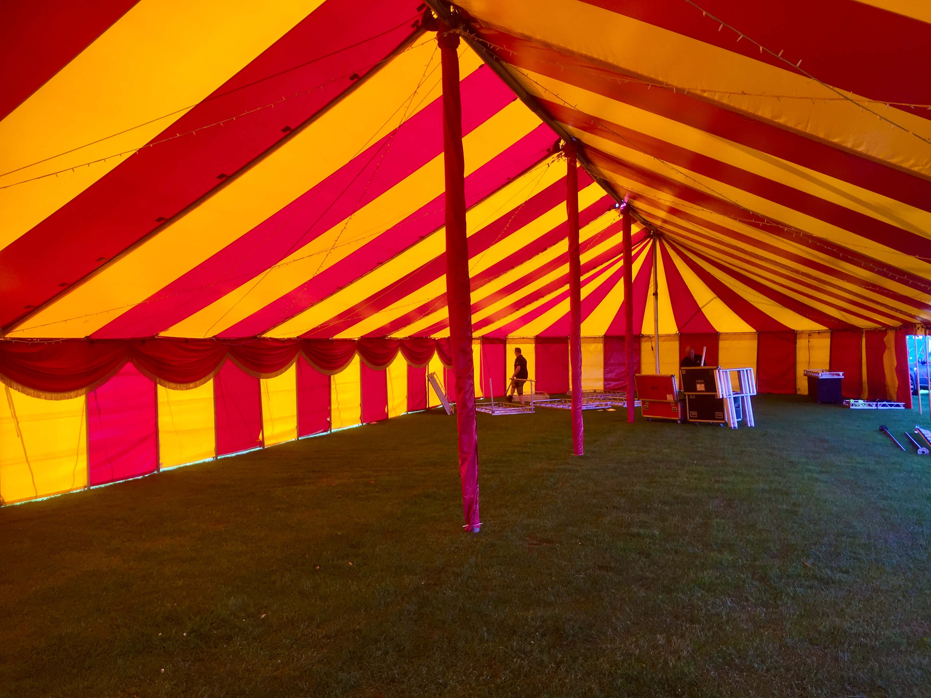 Inside the Queen a long red yellow marquee