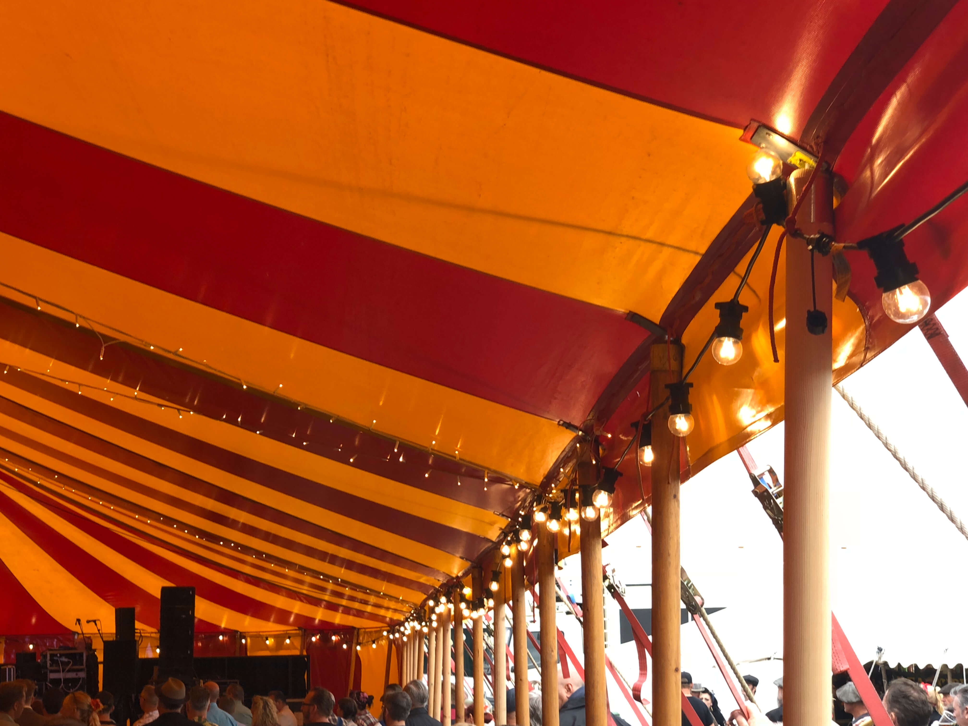 Beautiful wooden marquee side poles and festoons