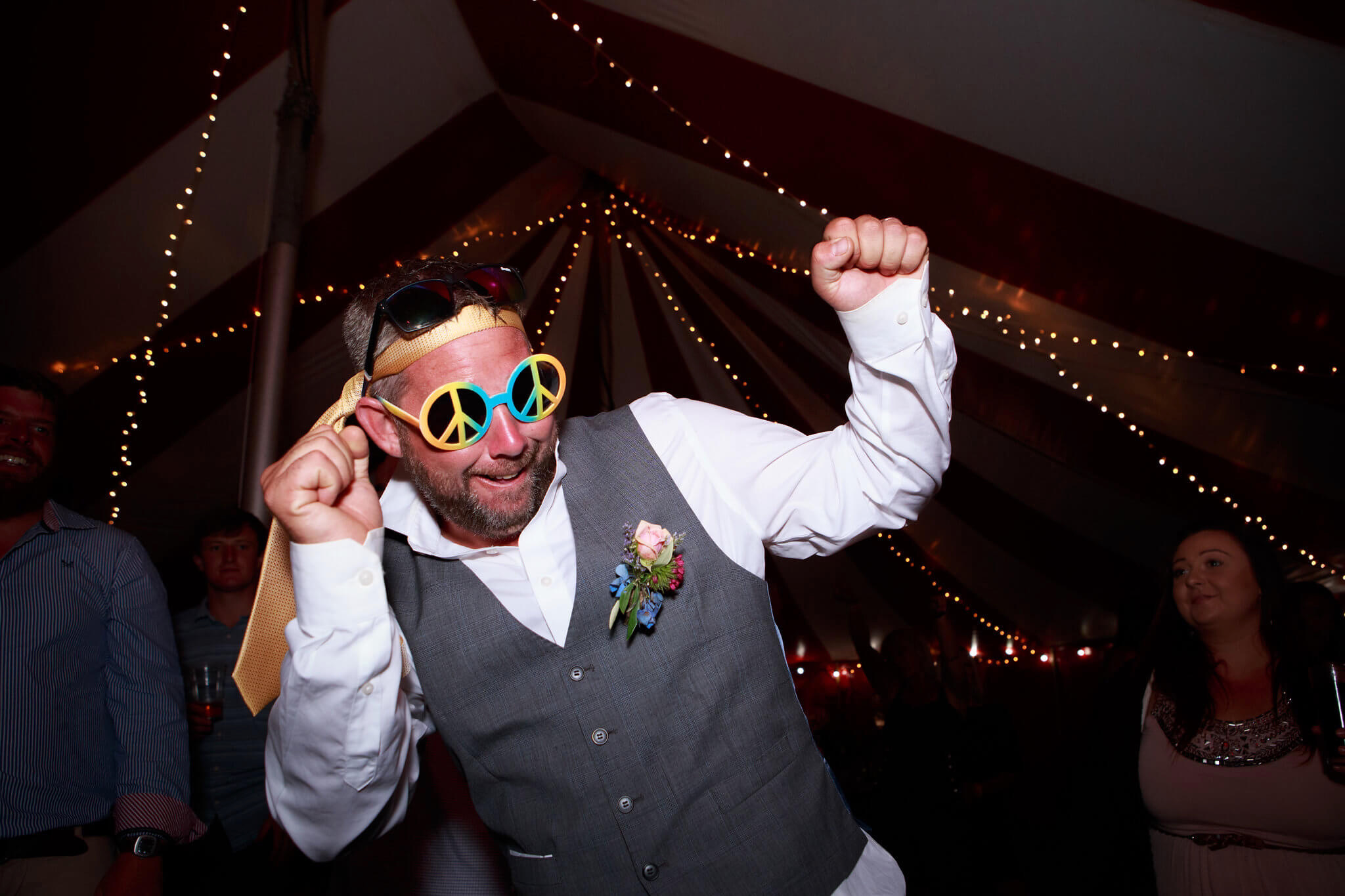 Groom partying in Cornish wedding marquee
