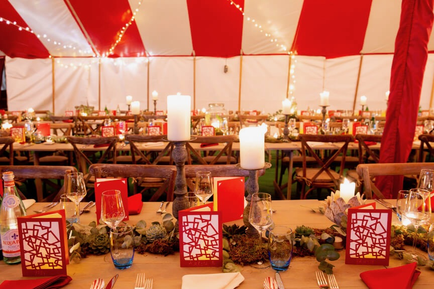 Matching red and white table decorations and marquee