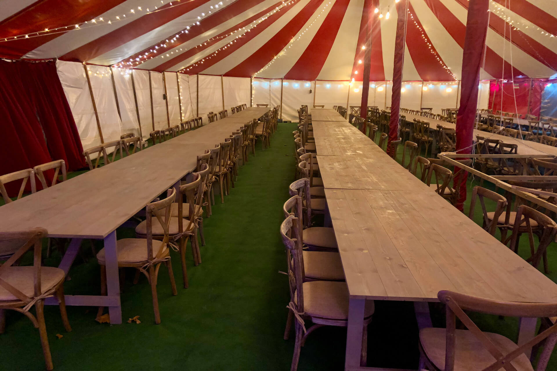 Rustic tables and cross back chairs for hire from DP Marquees in Blandford Dorset