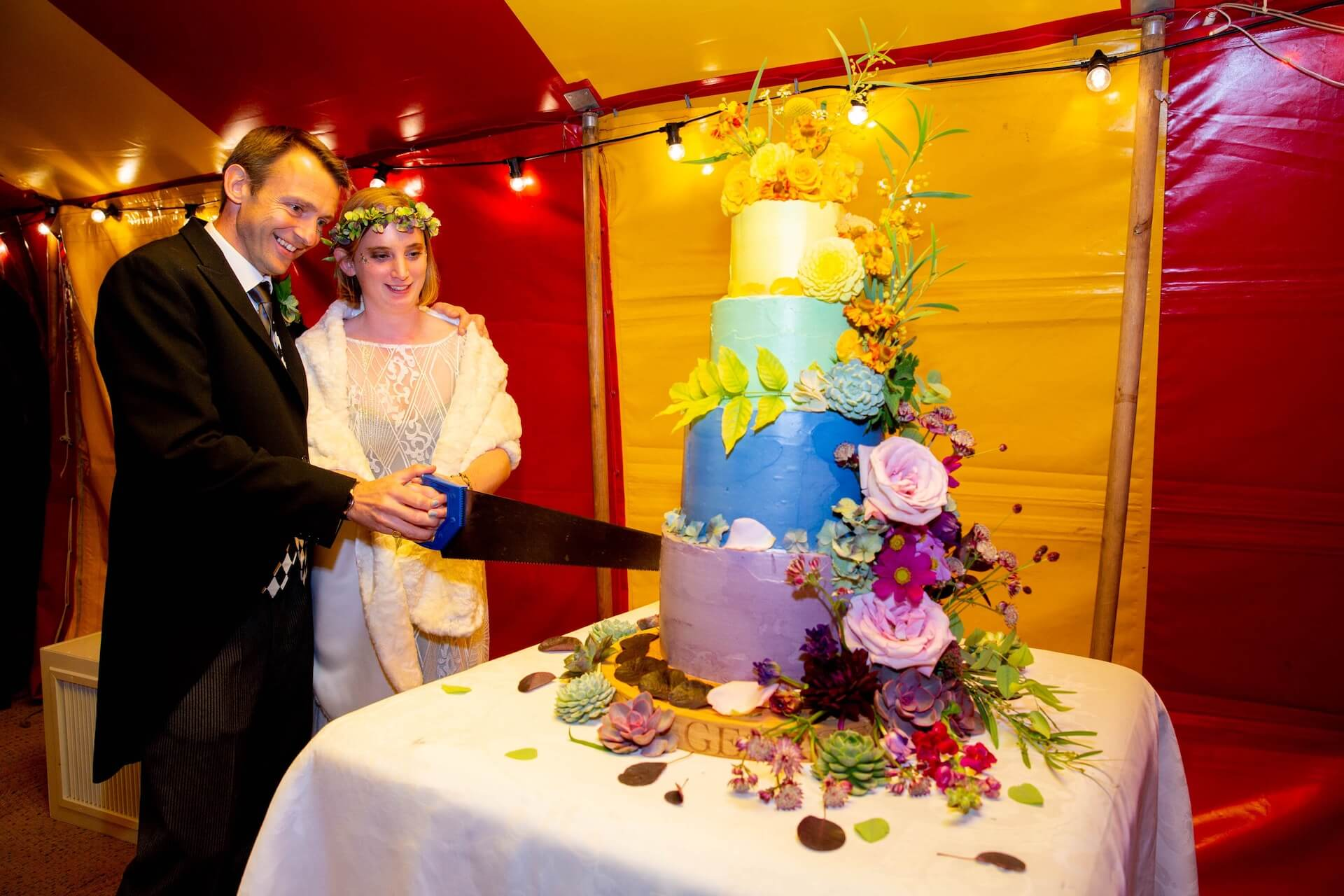 Cutting the wedding cake with a saw!