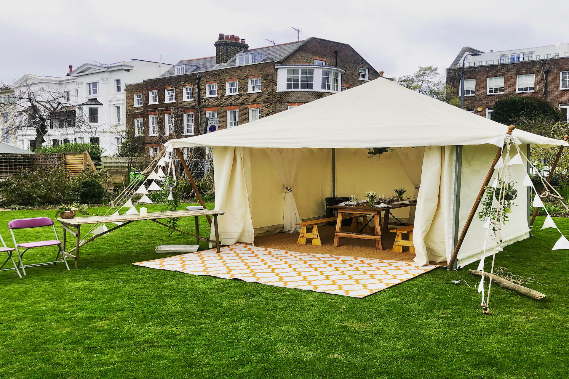 micro wedding marquee set up in a private garden.
