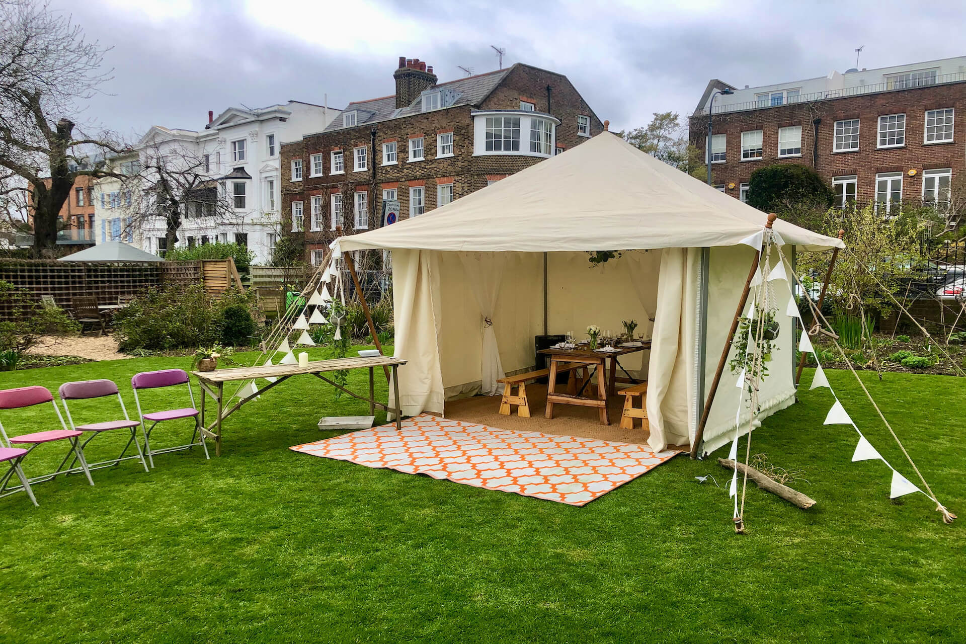 Family lunch party in london garden in a pcinic tent