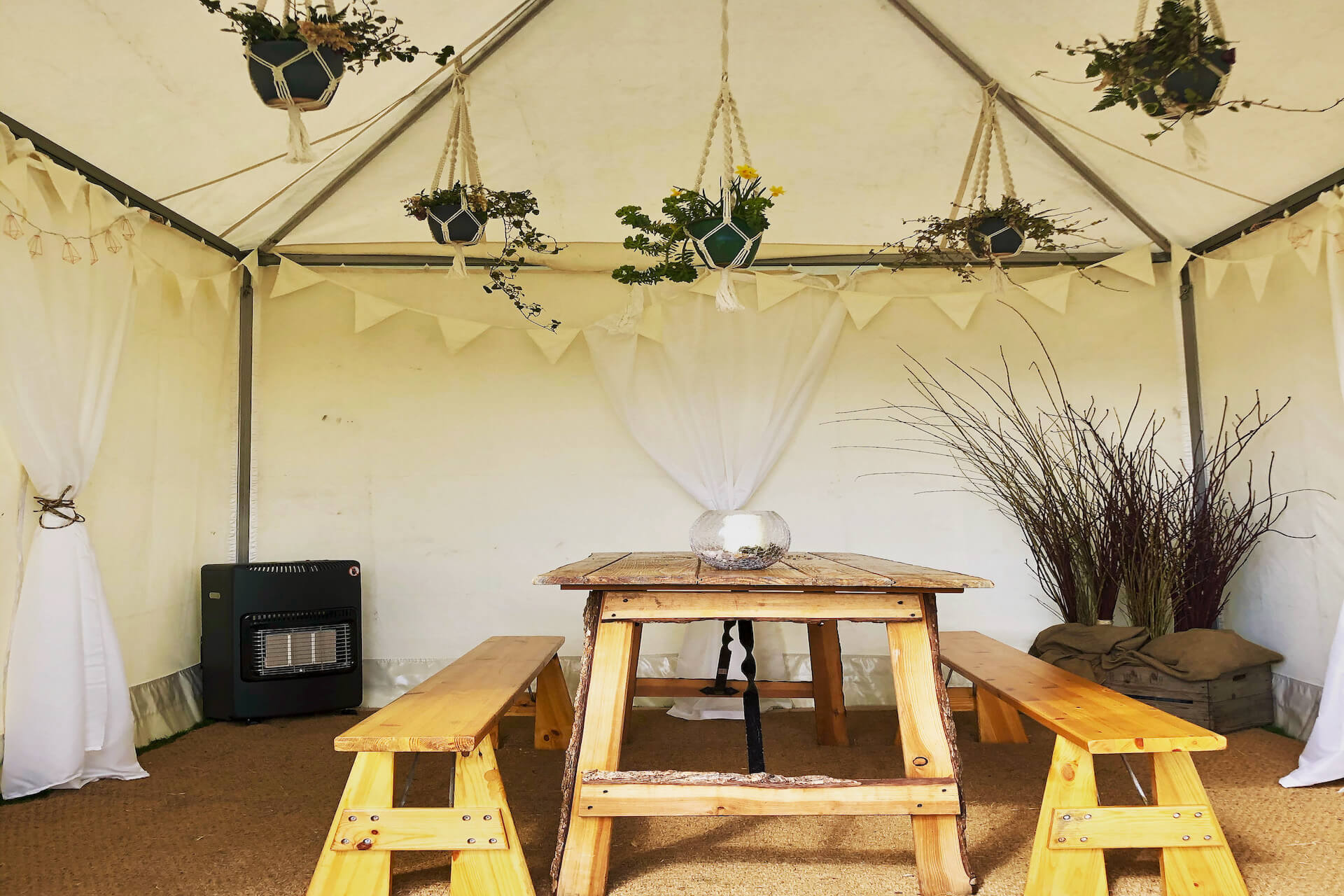 rustic styling features in a a tea rose picnic tent