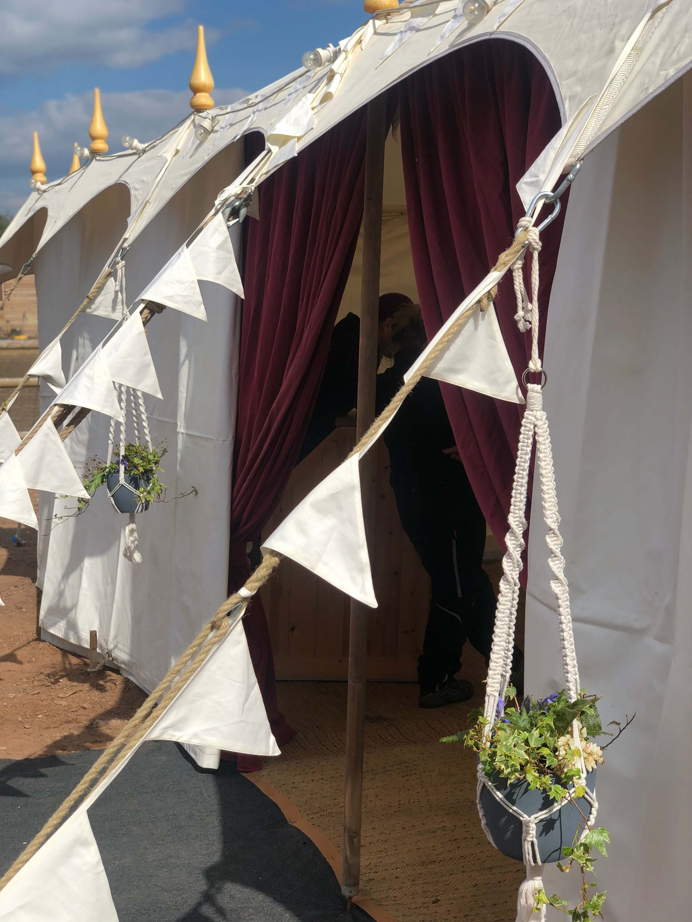 cream cotton bunting as wedding marquee styling decor