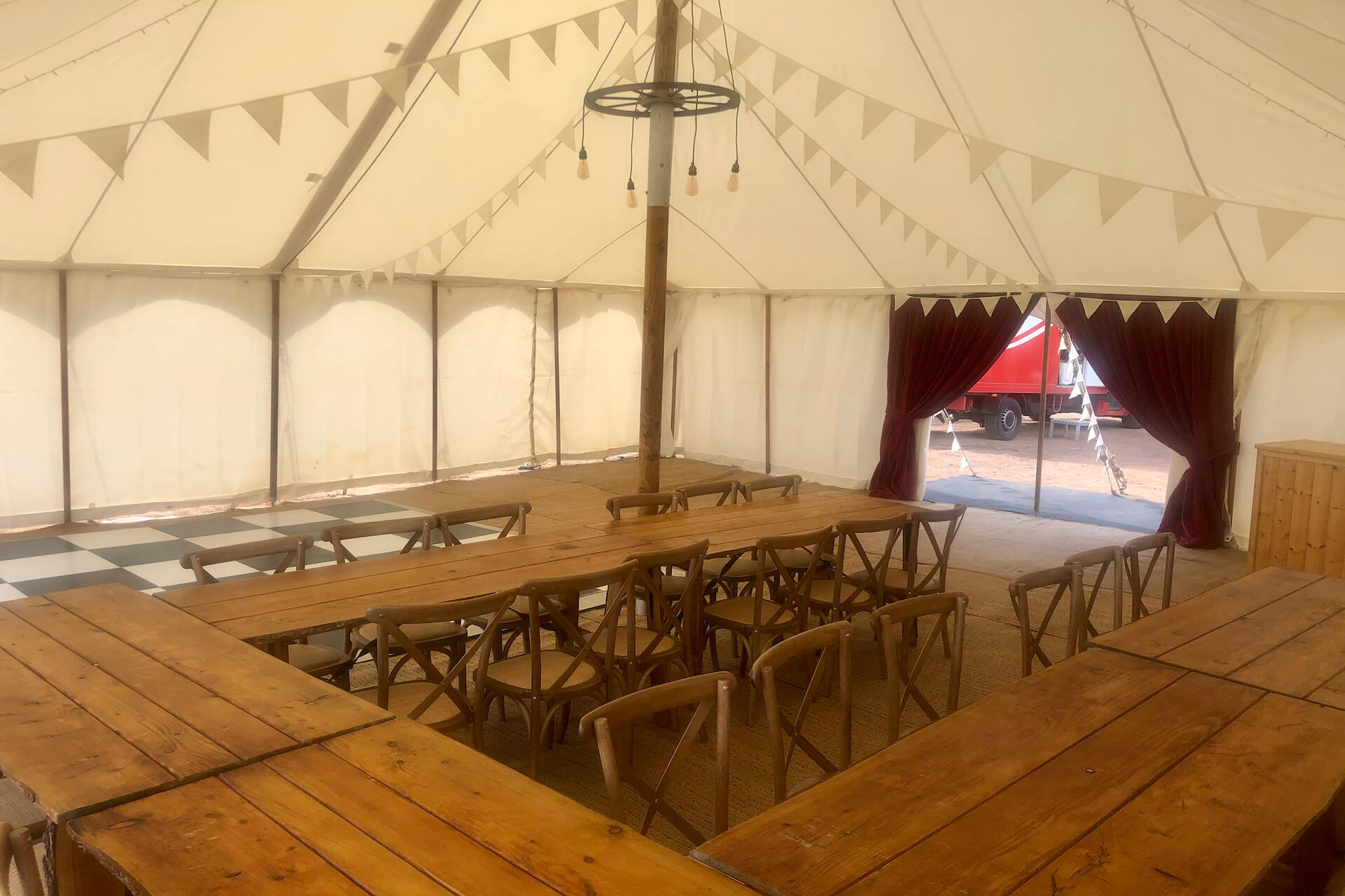 rustic tables and chairs in petal marquee