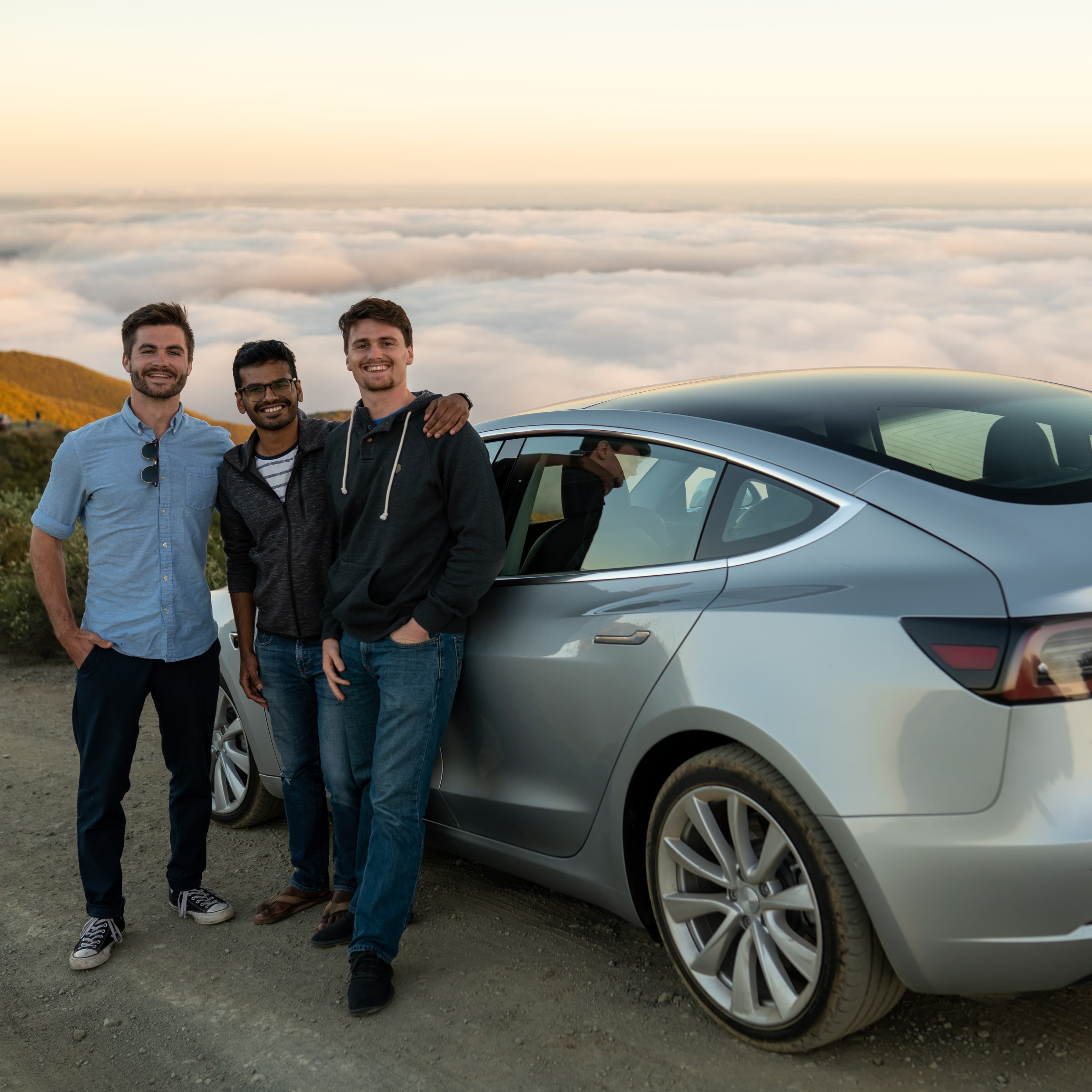 The NeoCharge team with a Tesla
