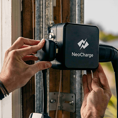 A NeoCharge Smart Splitter getting plugged in.