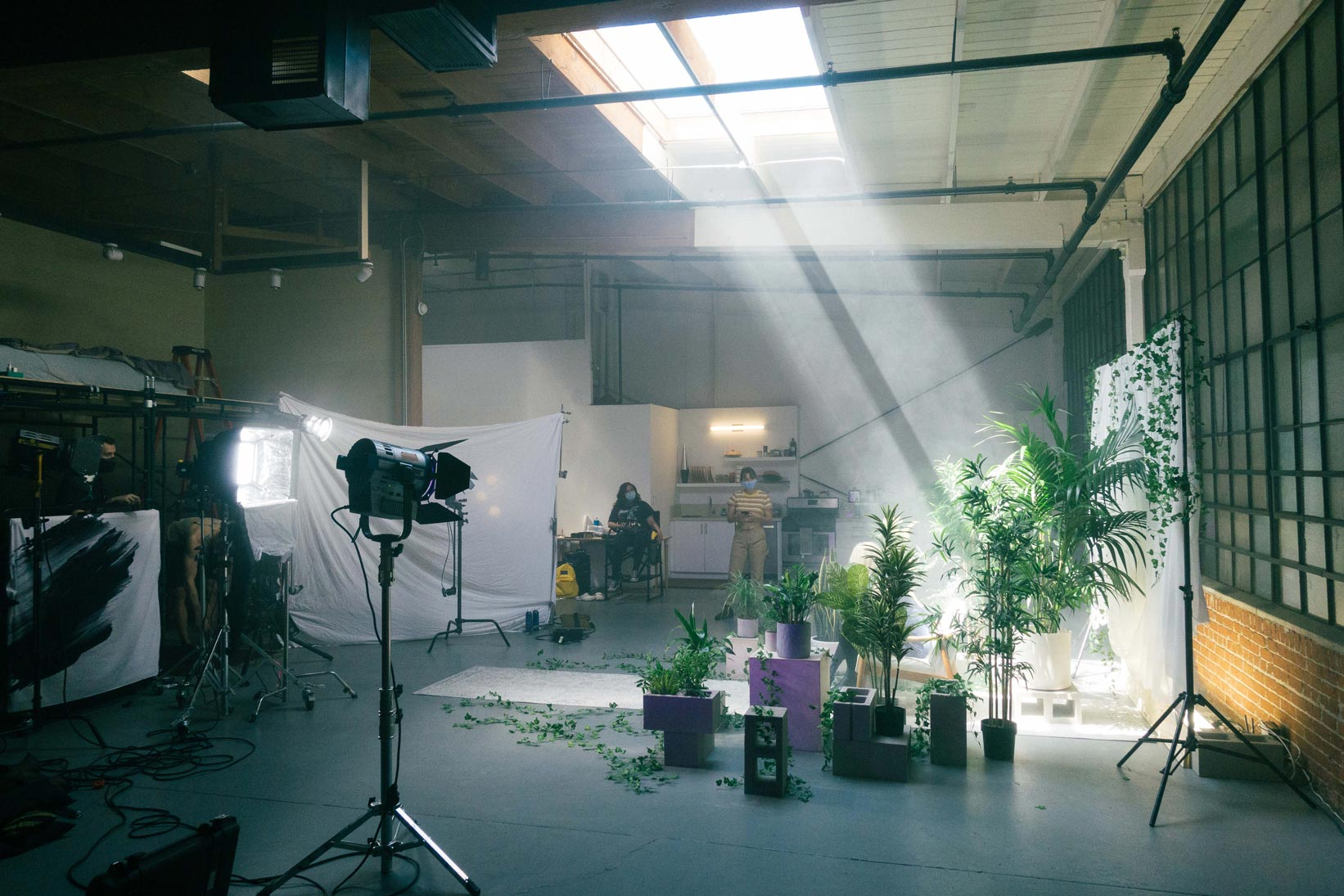 A beam of light lighting the studio with artificial haze and fog to increase the atmosphere look.