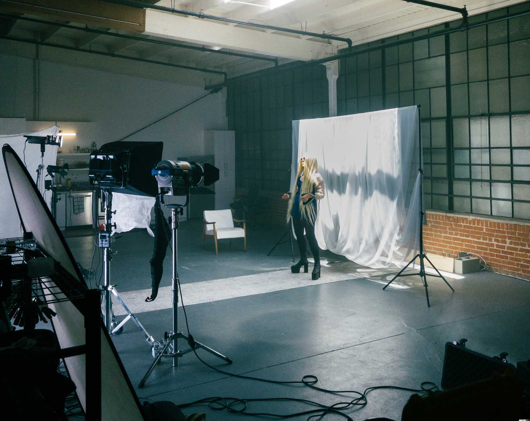 A behind the scenes shot of a past music video showing how lighting equipment can fit in the space.