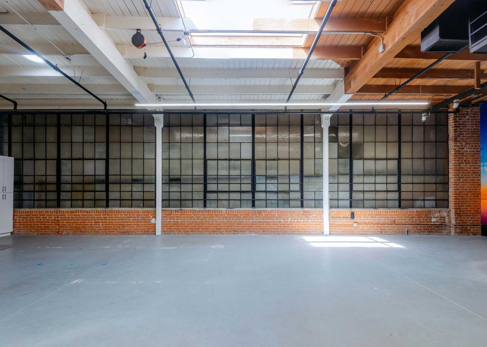 An empty vied of the wall of warehouse-style industrial windows.