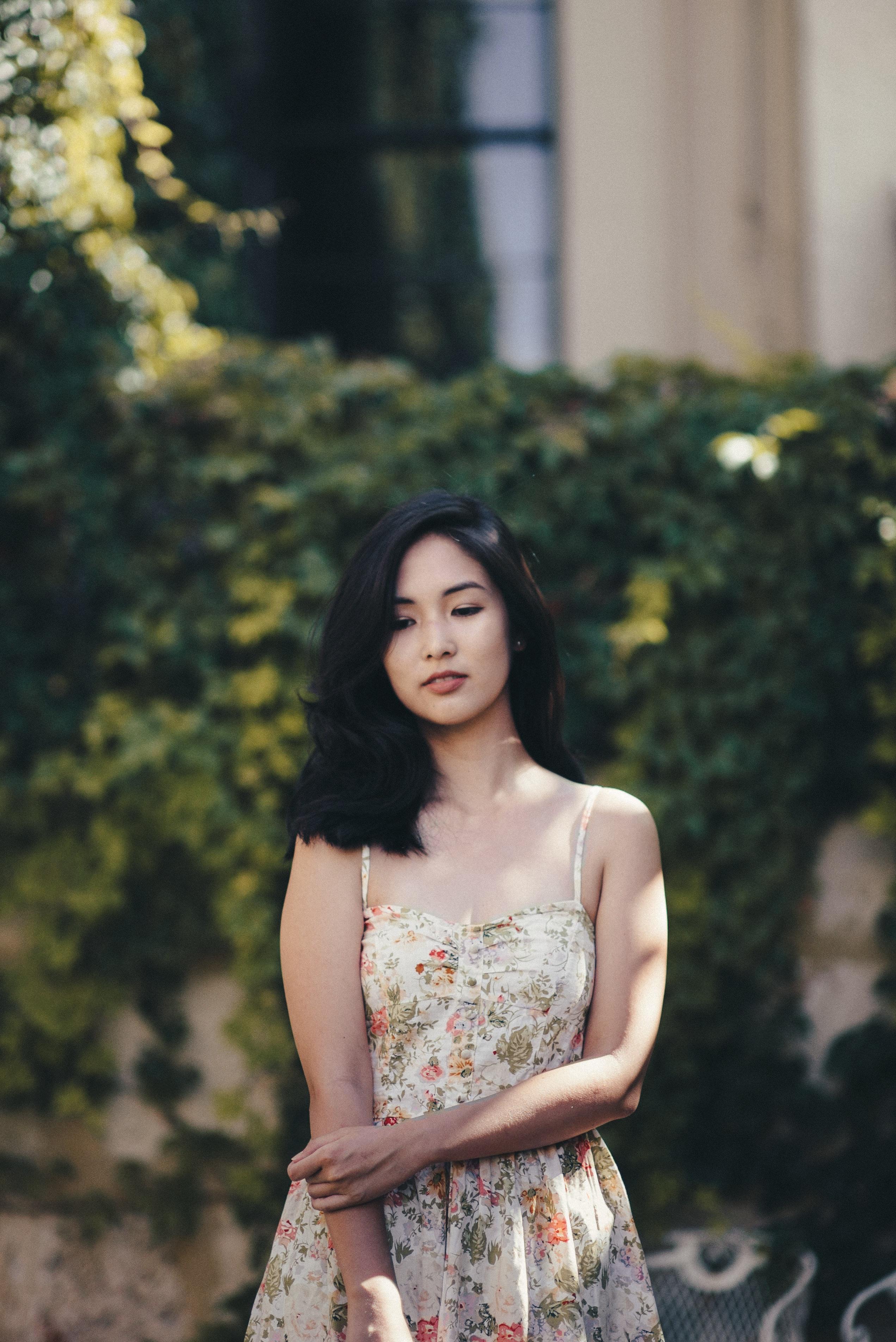 Girl in white sleevless floral dress