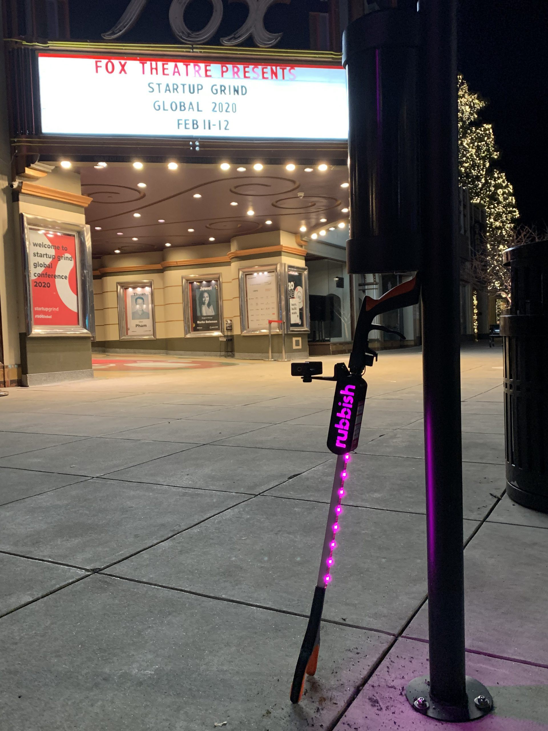 A LED-lit smart trash picker upper (Rubbish Beam) in front of the Fox Theatre