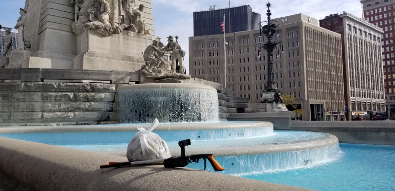 A bag of trash and the smart trash picker upper in front of The Soldiers and Sailors Monument