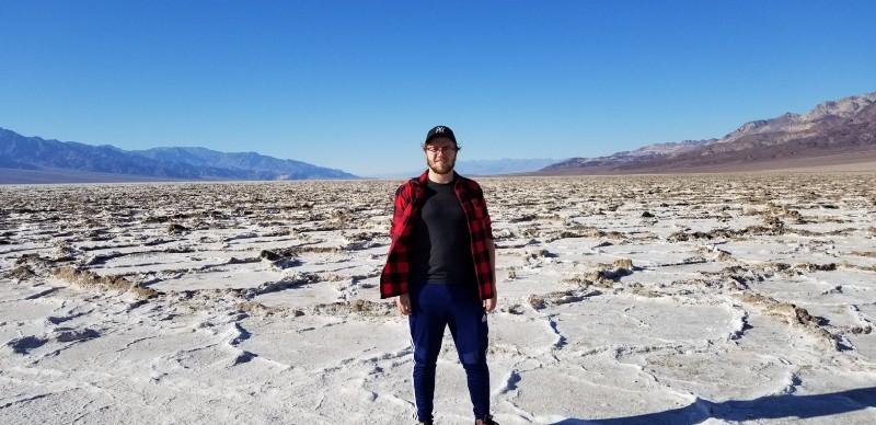 Adam with Death Valley pictured behind him
