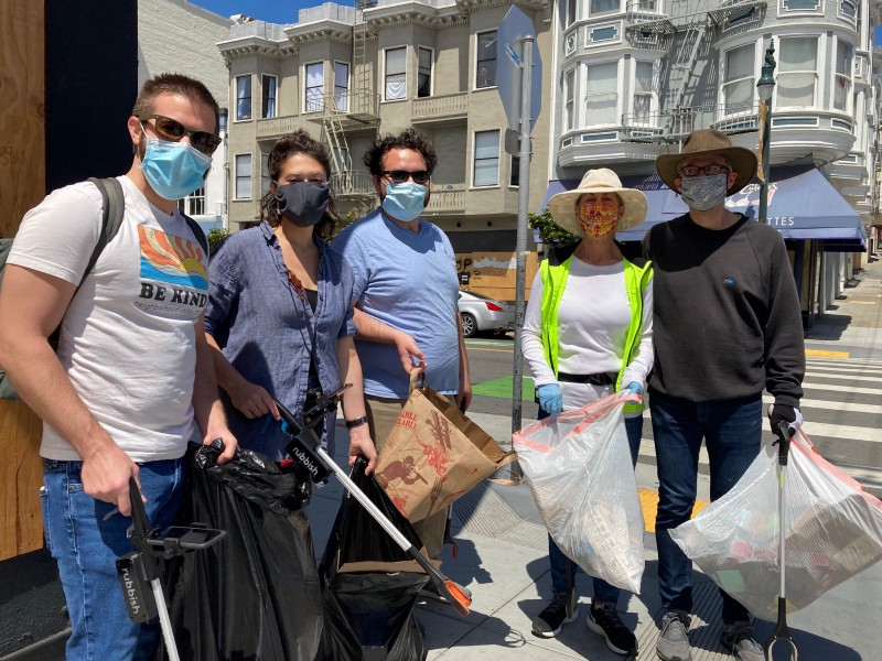 Photo of people holding bags of trash, and the smart trash picker uppers