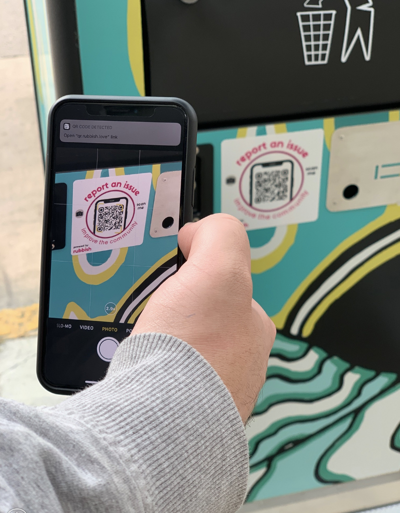 Using the phone's camera to scan the QR code on a BigBelly trash receptacle