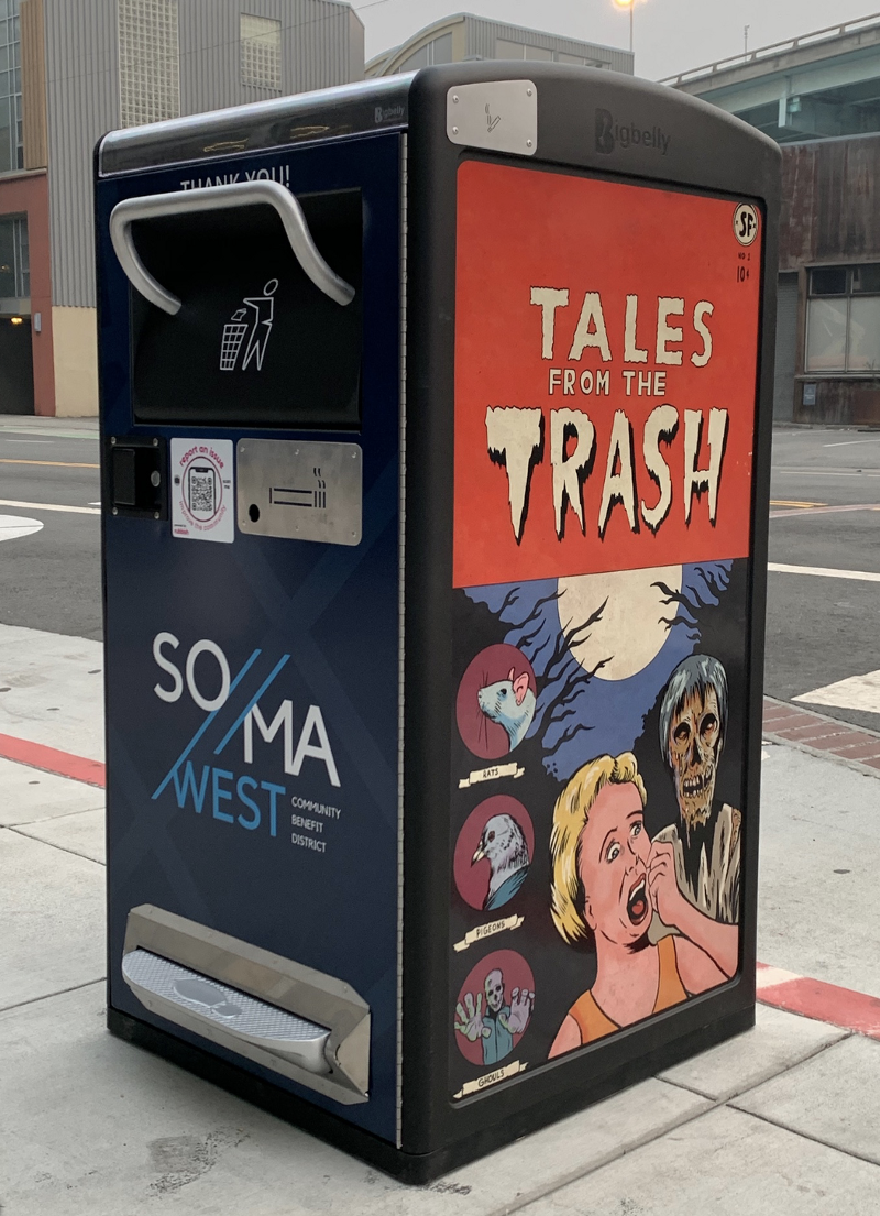 """BigBelly trash receptacle with artwork by Harry Nordlinger, titled """"Tales from the Trash"""" on the side panel"""