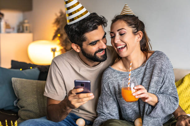 Couple wishing birthday on phone
