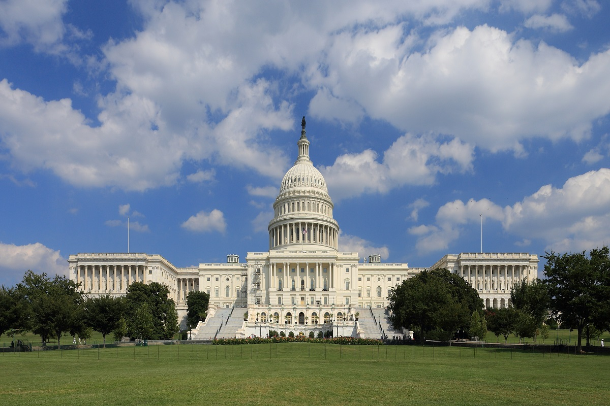 The west side of the United States Capitol building on a sunny day with clouds
