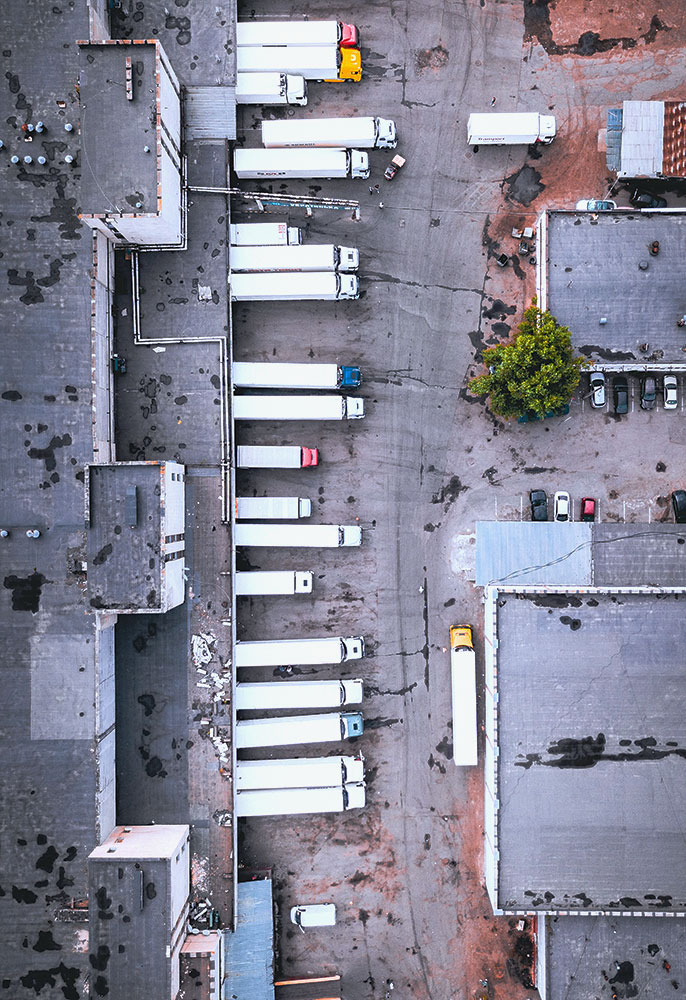 overhead view of parked delivery trucks